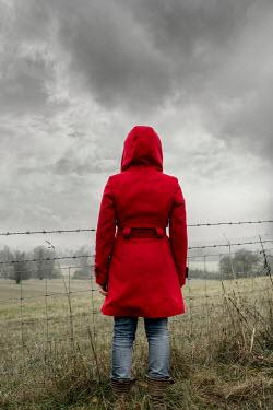 Stephen Mulcahey girl in red coat watching countryside Women