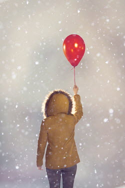 Emma Goulder WOMAN IN SNOW WITH BALLOON Women