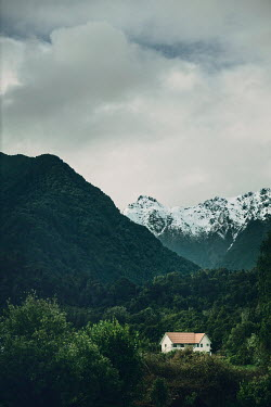Evelina Kremsdorf HOUSE IN VALLEY WITH SNOWY MOUNTAINS Houses