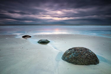 Evelina Kremsdorf STONES ON SANDY BEACH AT SUNSET Seascapes/Beaches