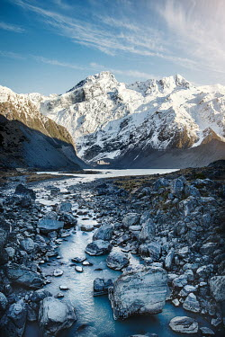 Evelina Kremsdorf SNOWY MOUNTAINS WITH ROCKS AND RIVER Rocks/Mountains
