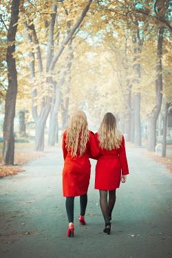 Ildiko Neer Two women walking on autumn road Women