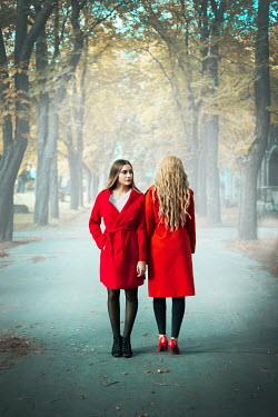 Ildiko Neer Two women standing on autumn road Women
