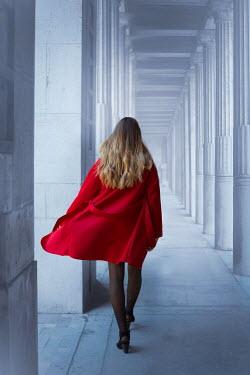 Ildiko Neer Young woman walking in grand building Women