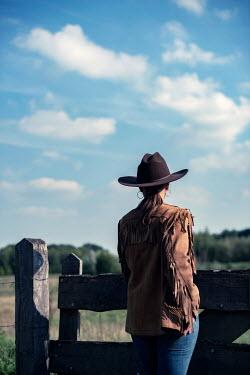 Ysbrand Cosijn WOMAN IN COWBOY HAT IN SUMMERY COUNTRYSIDE Women