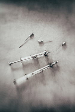 Des Panteva CLOSE UP OF TWO SYRINGES Miscellaneous Objects