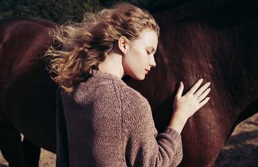 Daniil Kontorovich AFFECTIONATE BLONDE GIRL WITH HORSE Women