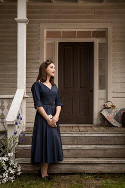 Michael Nelson RETRO WOMAN DAYDREAMING OUTSIDE HOUSE Women