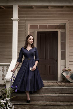 Michael Nelson RETRO WOMAN ON STEPS OUTSIDE HOUSE Women