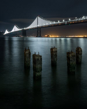 Paul Sheen SUSPENSION BRIDGE OVER RIVER AT NIGHT Bridges