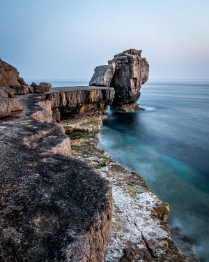 Paul Sheen BOULDER LEANING ON ROCK BY SEA Seascapes/Beaches