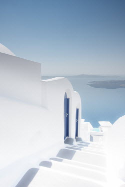 Ollie Taylor GREEK ISLAND WITH BLUE AND WHITE BUILDINGS Seascapes/Beaches