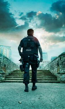 Stephen Mulcahey POLICEMEN IN CITY FROM BEHIND Men