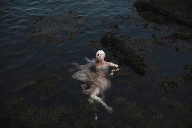 Aleah Ford WOMAN WEARING DRESS IN WATER Women