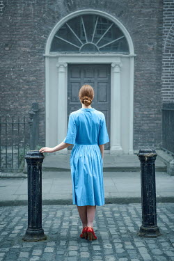 Magdalena Russocka retro woman standing at doorstep Women
