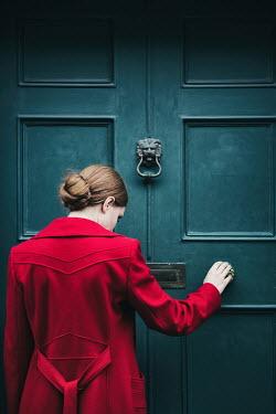 Magdalena Russocka woman in red dress pulling door Women