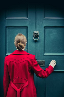 Magdalena Russocka woman in red coat pulling door Women