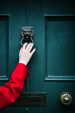 Magdalena Russocka close up of woman in red coat knocking on door Women