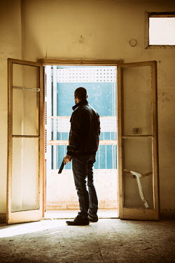 Mohamad Itani MAN WITH GUN IN DOORWAY Men