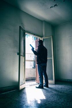 Mohamad Itani MAN HOLDING GUN NEAR OPEN DOORS Men
