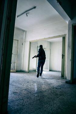 Mohamad Itani MAN RUNNING WITH GUN Men