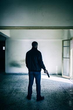 Mohamad Itani MAN HOLDING GUN NEAR OPEN DOOR Men