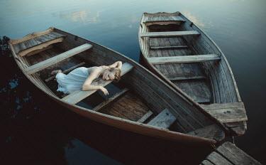 Dorota Gorecka WOMAN LYING IN BOAT Women
