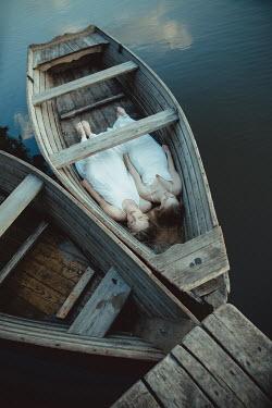 Dorota Gorecka TWO YOUNG WOMEN LYING IN BOAT Women