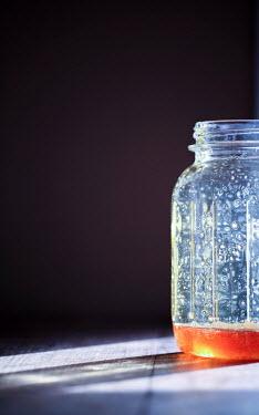 Jean Ladzinski GLASS JAR WITH ORANGE FLUID Miscellaneous Objects