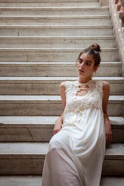 Miguel Sobreira WOMAN SITTING ON STONE STAIRCASE Women
