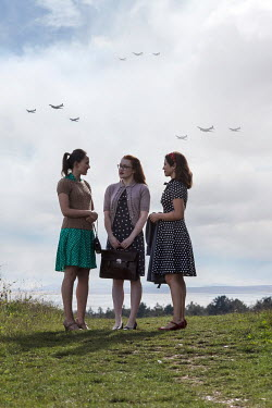 Stephen Mulcahey Three retro girls with planes flying Groups/Crowds