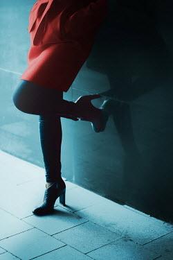 Ildiko Neer WOMAN LEANING BY WALL IN CITY Women