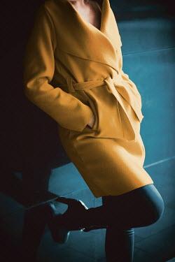 Ildiko Neer WOMAN IN YELLOW LEANING BY WALL Women