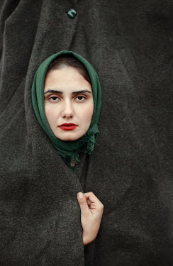 Felicia Simion WOMAN STARING OUT OF OVERCOAT Women