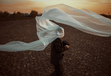 Felicia Simion MAN WITH HEAD COVERED IN WHITE SHEET Men