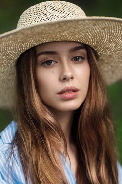 Maxim Guselnikov CLOSE UP OF TEENAGE GIRL IN HAT Women