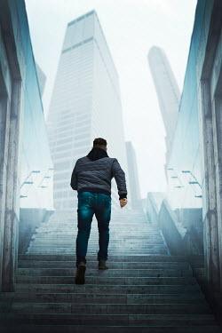 Ildiko Neer modern man climbing steps in city Couples