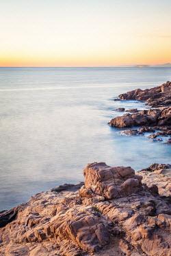 Des Panteva ROCKY COAST WITH SEA AT SUNSET Seascapes/Beaches