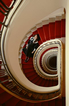 Felicia Simion GIRL LYING ON STAIRCASE FROM ABOVE Women