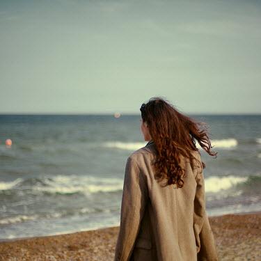 Felicia Simion WOMAN ON WINDY BEACH WATCHING SEA Women