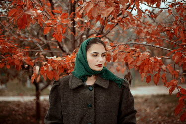 Felicia Simion WOMAN IN HEADSCARF BY AUTUMN TREE Women