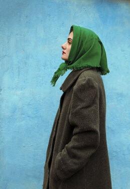 Felicia Simion RETRO WOMAN IN HEADSCARF BY WALL Women