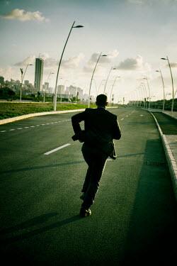 Mohamad Itani MAN RUNNING ON ROAD TOWARDS CITY Men