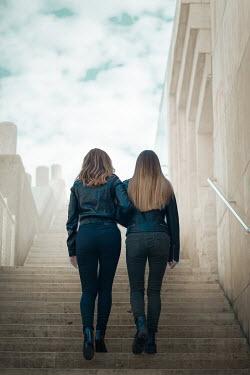 Ildiko Neer TWO WOMEN CLIMBING STEPS IN CITY Women