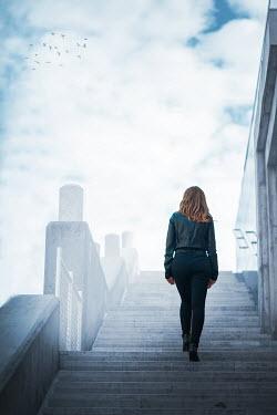 Ildiko Neer Young woman climbing steps Women
