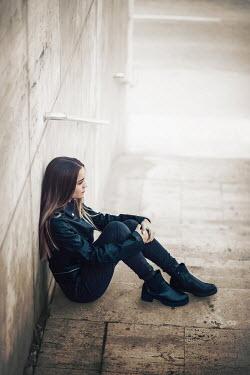 Ildiko Neer girl sitting on steps by wall Women