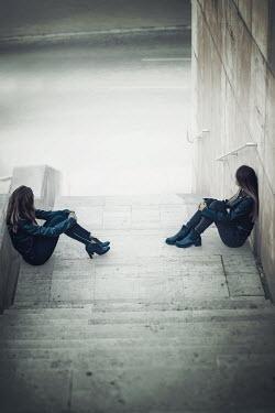 Ildiko Neer Two modern women sitting on steps Women