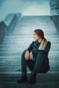 Ildiko Neer blonde modern woman sitting on steps Women