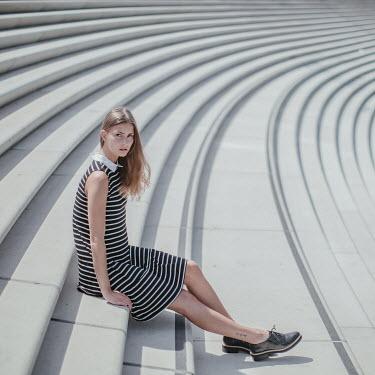 Dasha Pears GIRL SITTING ON STEPS IN STADIUM Women