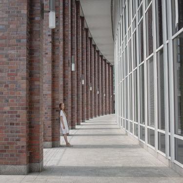 Dasha Pears GIRL STANDING OUTSIDE MODERN BUILDING Women